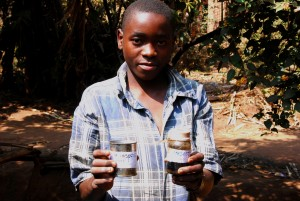 Abiudi Banda showing his natural insecticide.