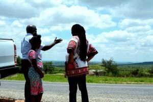 Mwizenge Tembo admiring the beautiful valley, while Temwani Banda and Mulenga Kapwepwe look on.