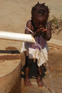 child at waterhole