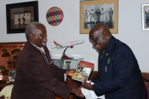 "Dr. Tembo handing a copy to President Kaunda a copy of his book: ""Satisfying Zambian Hunger for Culture"". The President wrote the foreword to the book."
