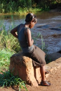 My niece Ruth Tembo waiting for a bus near our village on our return to Lusaka in December 2011