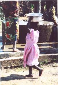 Girls learn chores and responsibility at a very young age.