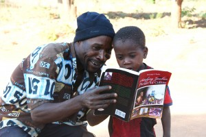 """A father who was in one of the photos in the book: """"Satisfying Zambian Hunger for Culture"""" shows his son. This was at Chikana Village in Chief Magozi's area West of Lundazi in November 2012."""