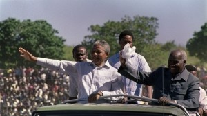 In the patriotic article Prof. Mwenda says Nelson Mandela went to Zambia first during his first visit abroad after 27 years in prison. Nelson Mandela with President Kaunda in Zambia in 1990.