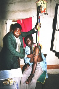 A traditional healer or ng'anga diagnosing a patient who had chronic pain in his shoulder and arm.