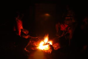Enjoying the fire in the village. What is the relationship between fire and the speed of light?